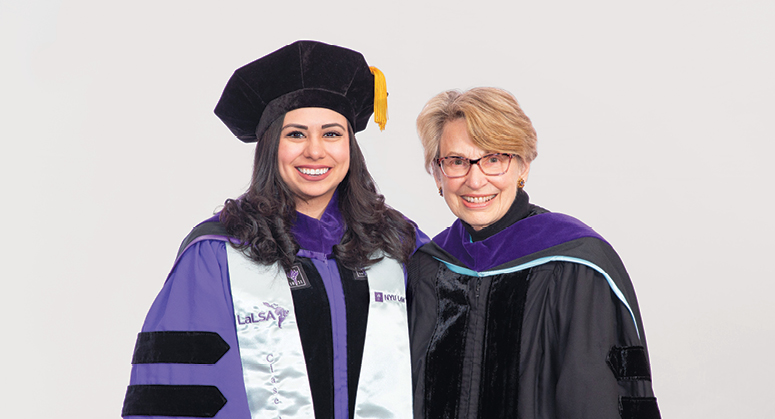Thomas E. Heftler Scholar Melissa Quintana was hooded by Lois Weinroth