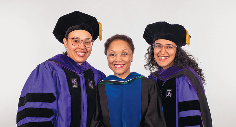 Derrick Bell Scholars for Public Service (LACA) Lauren Richardson and Devika Balaram were hooded by Janet Dewart Bell