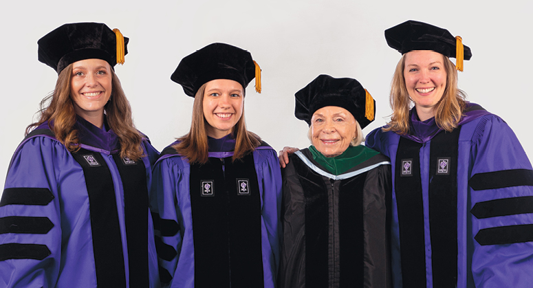 Joyce Lowinson IILJ Research Scholars Isabelle Glimcher, Sarah Coco, and  Alissa Clarke were hooded by Dr. Joyce Lowinson. Not pictured: Nathaniel Eisen