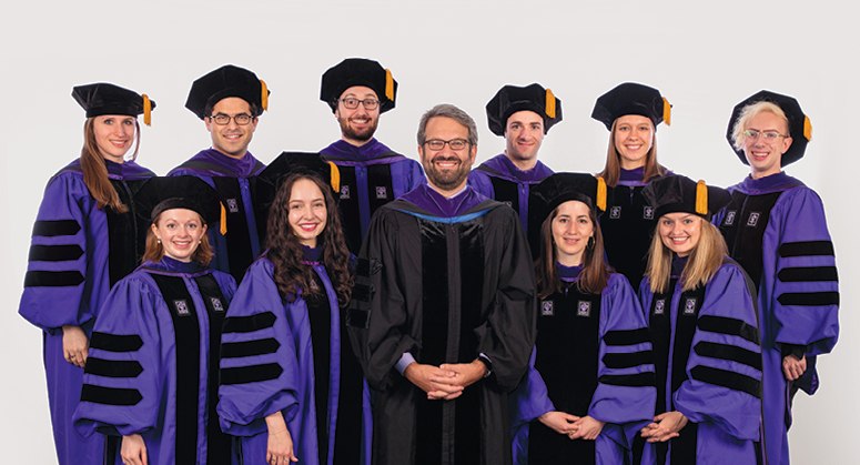 Furman Academic and Public Policy Scholars, Back Row: Victoria Wenger, Samuel Himel, Sam Bieler, Adam Kern, Sarah Coco, Evan Gilbert Front Row: Alison Perry, Meghan Racklin, Elizabeth Jánszky, and Natalie Jacewicz. The graduates were hooded by the Honorable Jesse Furman