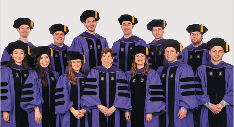 Jacobson Leadership Program in Law and Business Scholars, Back Row: Timothy Keegan, Daniel Raymer, Michael Rusie, Christopher Bhutani, Daniel Krantz, Keith Pulling Front Row:  Christine Choi, Michelle Chern, Clara Aragone-Diaz, Eliza Chute, Bix Bettwy, and Anthony DeRiso III. The graduates were hooded by Professor Helen Scott