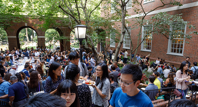 Students talking and eating in Vanderbilt Hall Courtyard for Orientation 2019 BBQ