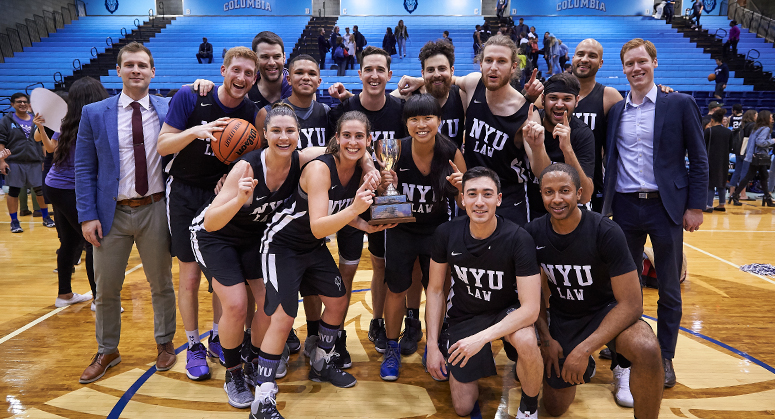 NYU Law basketball team with Dean's Cup trophy