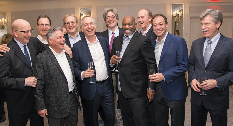 A group of alumni laughing and mingling together at the 2018 NYU Law Reunion