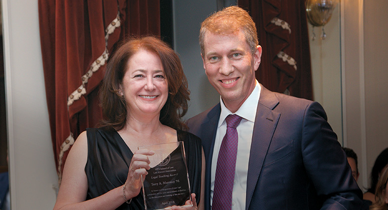 Terry Maroney '98 with Dean Trevor Morrison receiving her award at the 2018 NYU Law Reunion