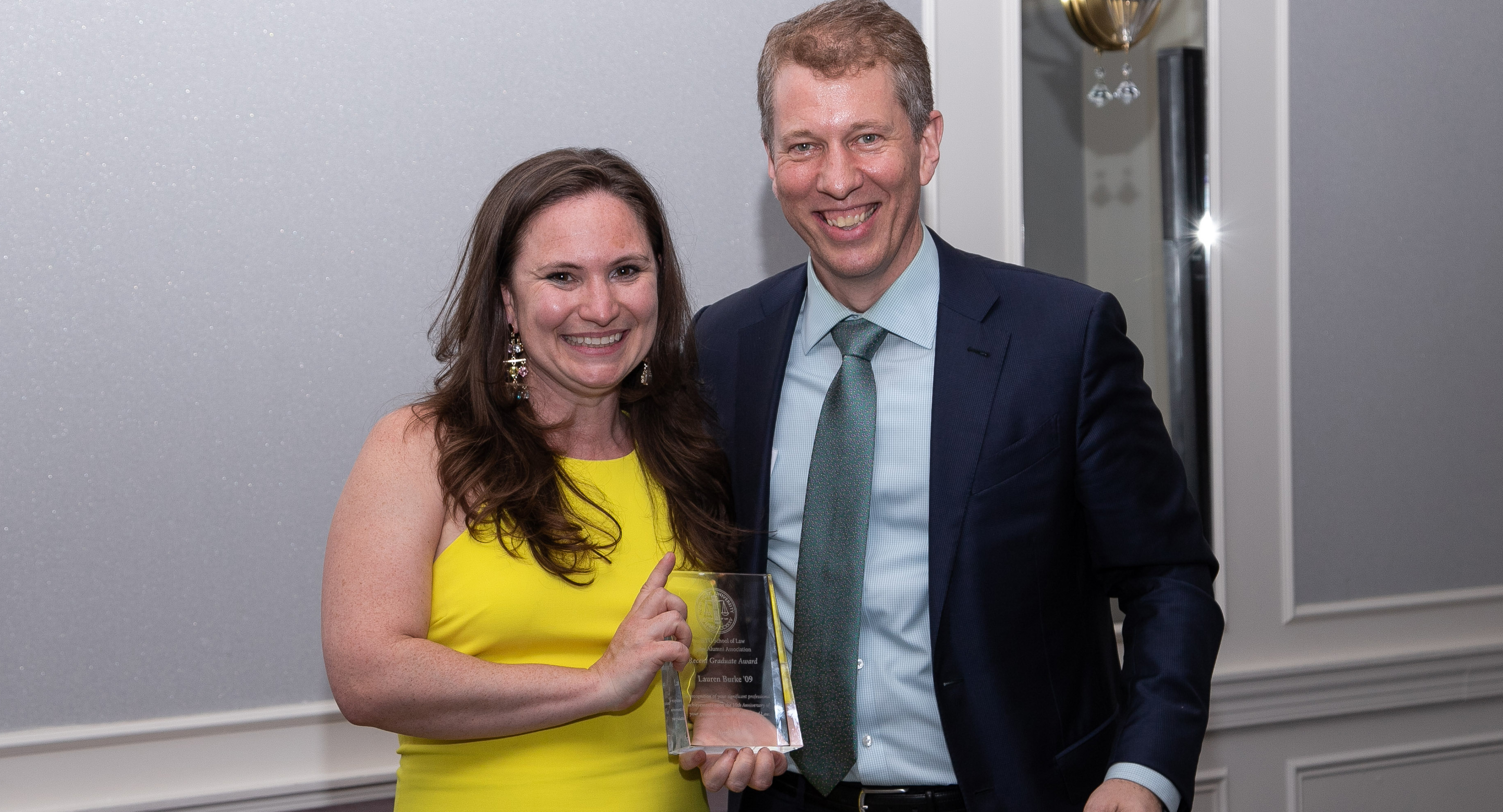 Lauren Burke receiving an award from Dean Trevor Morrison at Reunion 2019