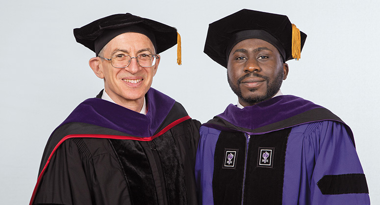 Erich Leyens Scholar Oluwasegun Motajo was hooded by Vice Dean Randy Hertz