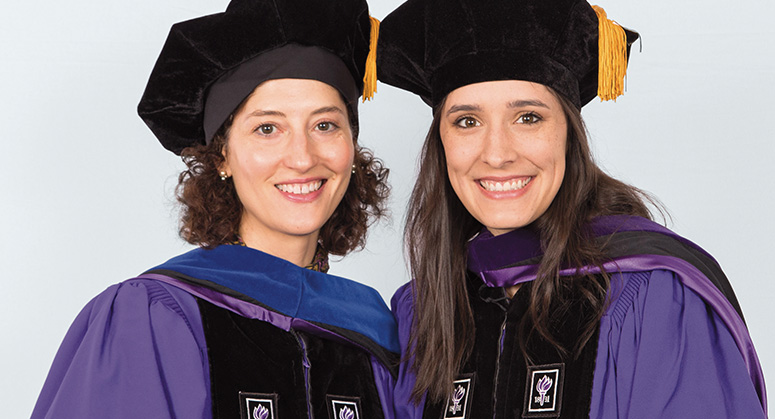Judge M. Blane Michael Scholar Virginia Kirkland (right) was hooded by Cora Michael