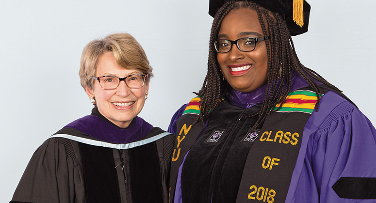 Thomas E. Heftler Scholar Kashira Patterson was hooded by Lois Weinroth