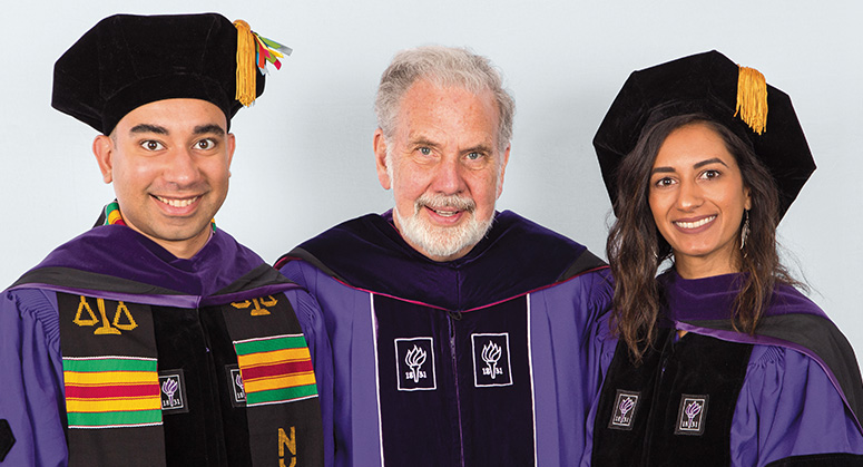 John Sexton Scholars Vladimir Alexander and Lamya Agarwala were hooded by Professor John Sexton, Benjamin F. Butler Professor of Law, President Emeritus of New York University, and Dean Emeritus of the Law School