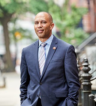 Hakeem Jeffries standing in front of Brooklyn brownstones