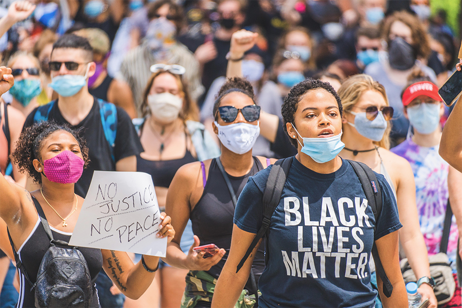 Protestors wearing face masks during the coronavirus pandemic march in support of the Black Lives Matter movement.