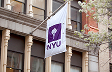NYU flag with torch
