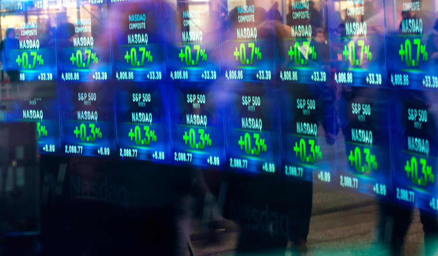 Screens with stocks at the New York Stock Exchange