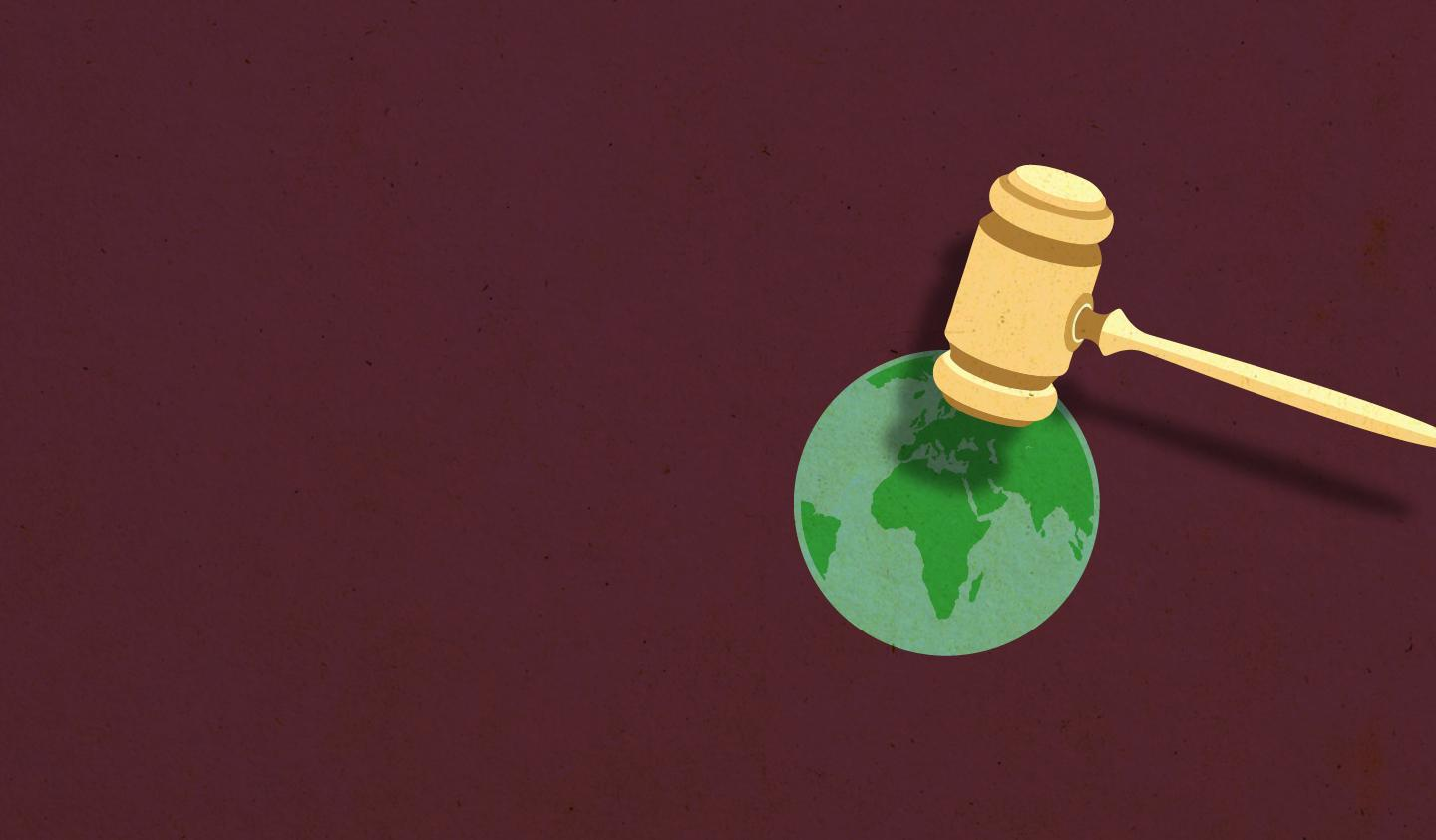 gavel on top of world map