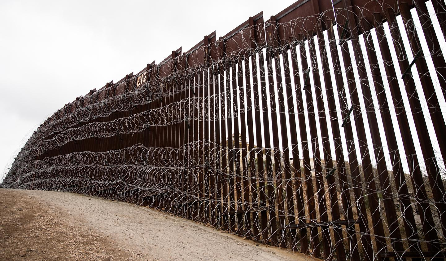Layers of Concertina are added to existing barrier infrastructure along the U.S. - Mexico border near Nogales, AZ, February 4, 2019. Photo: Robert Bushell