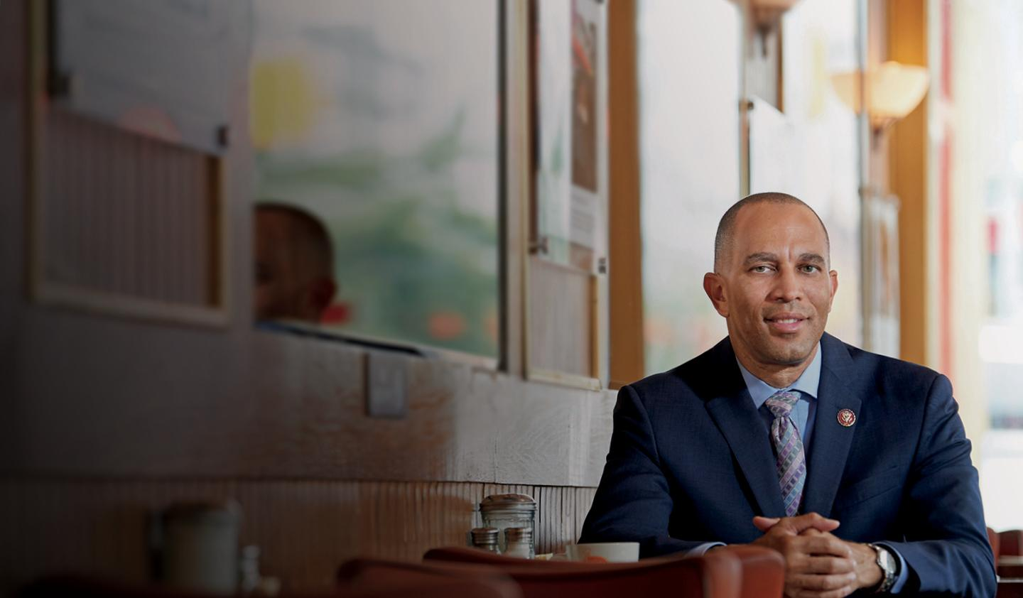 Hakeem Jeffries sitting at table in diner