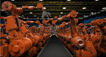 Robotic arms along a conveyor belt in a manufacturing facility