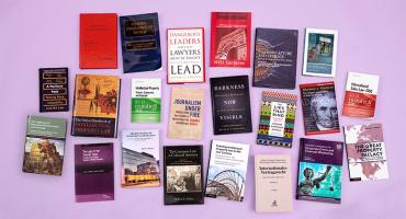 photo of 22 books by NYU Law faculty members