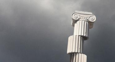 Fragmented greek column with storm clouds in background