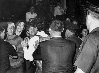 Stonewall Inn nightclub raid. Crowd attempts to impede police arrests outside the Stonewall Inn on Christopher Street in Greenwich Village.