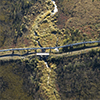 An aerial view of a pipeline crossing a stream.